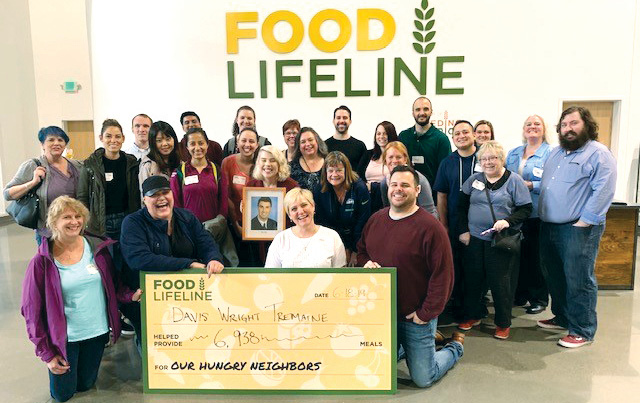 DWT volunteers at the Hunger Solution Center. Johnson is represented by his board member headshot, as he had to leave before the photo was taken.